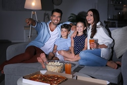 watching a family movie: an idea of activity to keep children at home